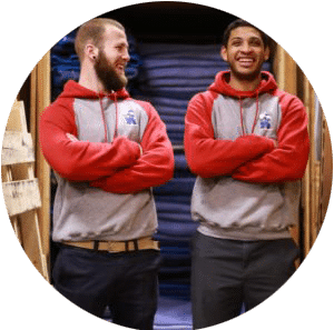 two movers smiling with arms crossed