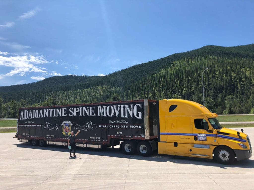 moving truck with scenic green mountains in background